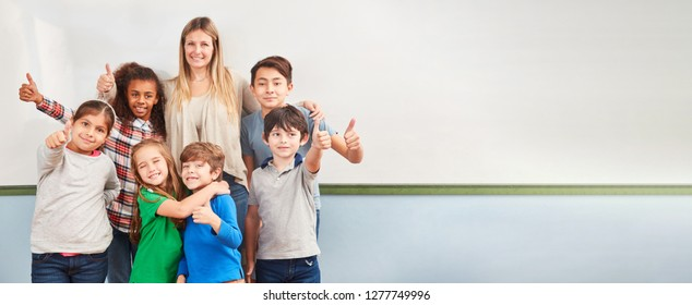 Multicultural children in elementary school class keep their fingers crossed