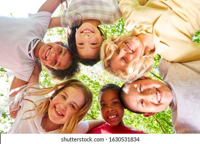 Multicultural children group in circle for friendship and diversity