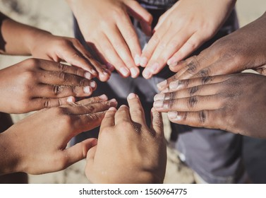 Multicultural children's hands in a circle