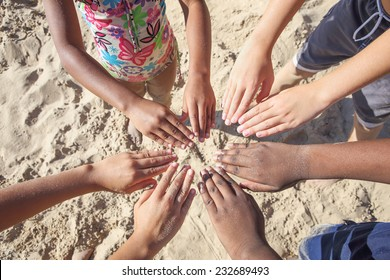 Multicultural childrens hands in a circle.