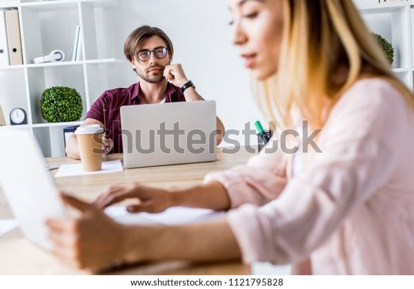 multicultural colleagues working on startup project in office with laptops