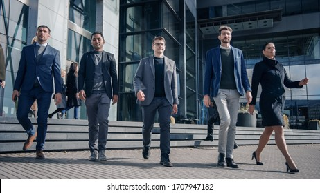 Multicultural Diverse Office Managers and Business People Walking in Front on the Camera. They Look Smart and Successful. Pedestrians are Dressed Smartly. Business Department Walking in Downtown.