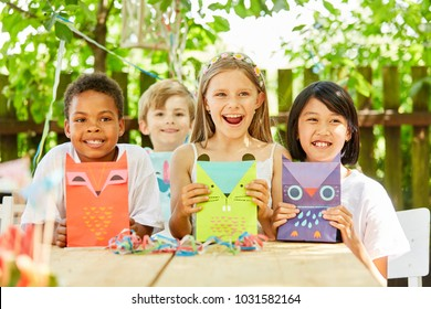Multicultural group of kids with creative gift bags on kids birthday