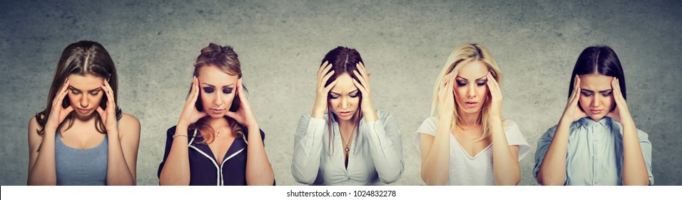 Multicultural group of sad young beautiful women with worried stressed face expression looking down