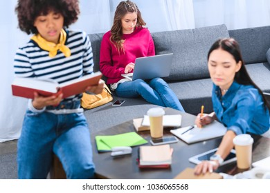 multicultural group of young students studying together