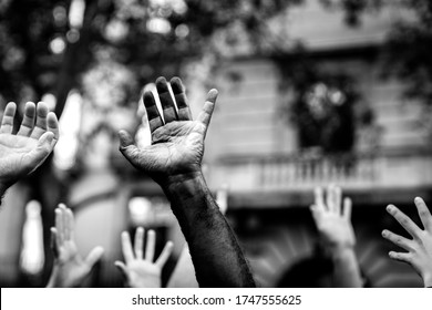 Multicultural hands raised in the air asking for freedom. Stop racism. Stop repression.
