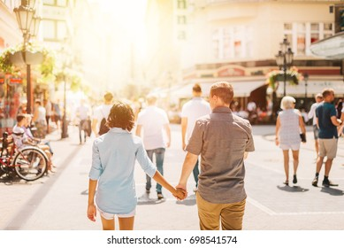 Multicultural Happy Couple Tourists Walking Down The Street Holding Hands | Honey Moon