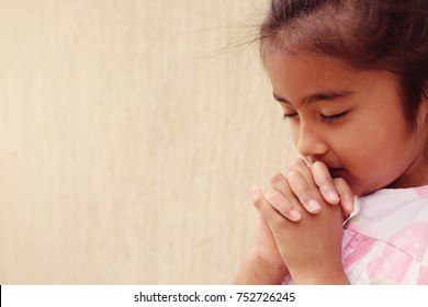 multicultural hispanic girl child praying with eyes closed, christianity faith concept, World Day of Prayer,international day of prayer