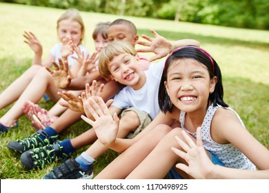Multicultural kids having fun and waving as friends