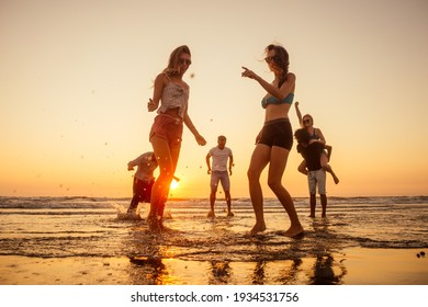 multicultural multinational happy people running into the sun carefree and happiness, vacation on sea