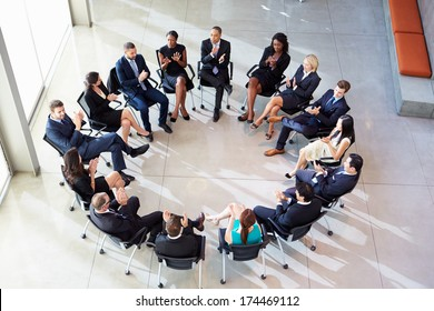 Multi-Cultural Office Staff Applauding During Meeting