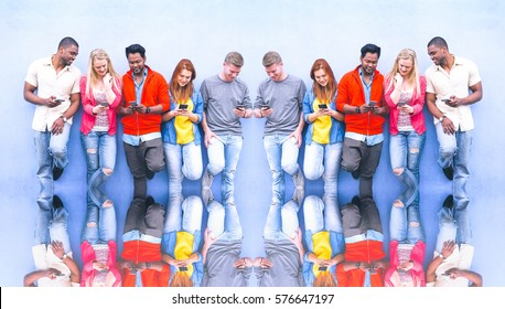 Multicultural row of students texting phone message on blue copy space background - Clones of different young group of people looking down at mobile - Social media technology global addiction concept