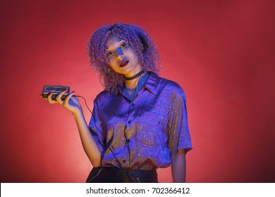multicultural young woman with headphones and a walkman listening to some electronic music