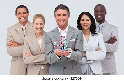 Multi-ethnic business people holding a molecule model. Science and business concept