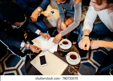 Multiethnic Business people meeting in office top view