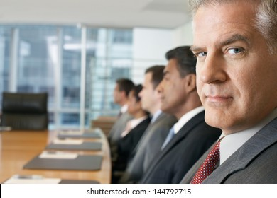 Multiethnic business people sitting in row at conference meeting