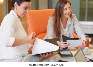 Multi-Ethnic Business people working in business lobby in important strategy