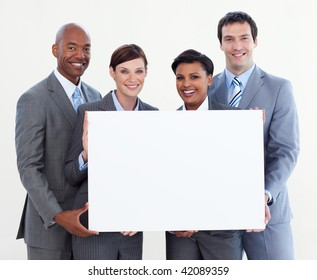Multi-ethnic business team holding white card isolated on white background
