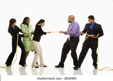 Multi-ethnic businessmen  playing tug of war against businesswomen.