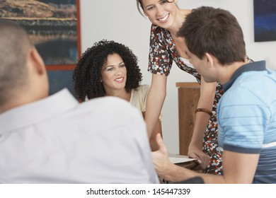 Multiethnic Businesspeople in meeting at conference table