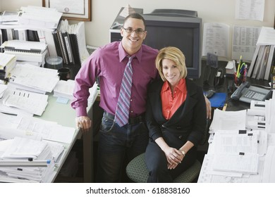 Multi-ethnic businesspeople next to desk