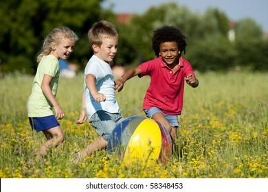 Multi-ethnic children playing ball