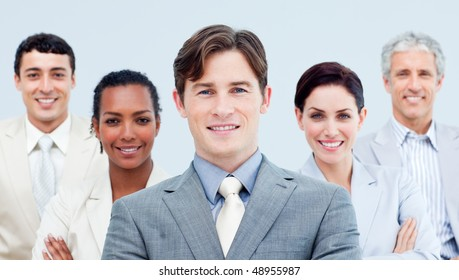 Multi-ethnic confident business partners standing with folded arms