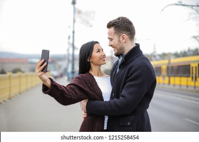 Multi-ethnic couple enjoying each other's company in the city.