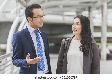Multiethnic diverse Business people discussion while walking at street. Creative team,coworker, or college students in strategic meeting or project brainstorm. Startup investment and teamwork concept