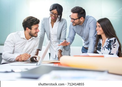 Multiethnic diverse group of creative team, casual business people in strategic meeting or project brainstorm in modern office.