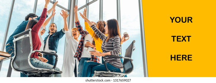 Multiethnic diverse group of happy office coworker or business partner join hands celebrating together. Banner copy space for advertising text. Partnership teamwork, or successful team project concept