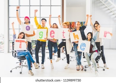 Multiethnic diverse group office coworker or creative people hold word together, cheer and celebrate. Business project partner, corporate teamwork, company activity, or friendship togetherness concept