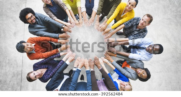 Multi-Ethnic Diverse Group of People In Circle Concept