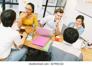 Multiethnic diverse group of people at work. Creative team, casual business coworker, or college students in strategic meeting or project brainstorm discussion at office. Startup or teamwork concept