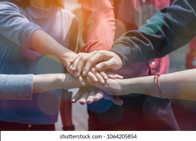 multiethnic ethnic business people or politicians putting hand harmonious friendship together,group of diversity people volunteer community service.start up business partner teamwork together concept.