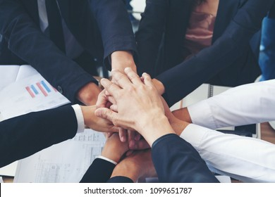 Multiethnic Ethnic Business People or Politicians voluntary Putting hand har Monious Friendship Together, Friends with Stack of hands Showing unity and Trust worthy Partnership Teamwork