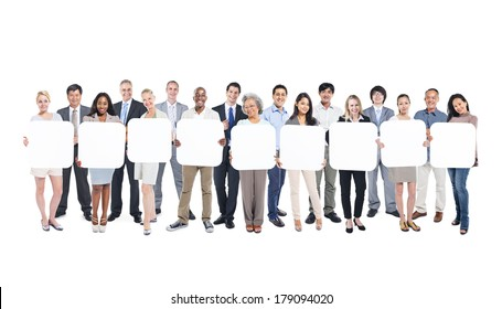 Multi-Ethnic Group Of Business And Casual People Holding 9 Empty Cardboards