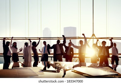 Multi-Ethnic Group Of Business People Celebrating In Board Room