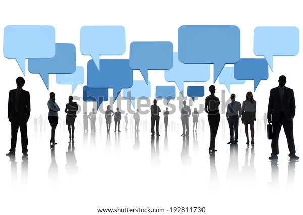 Multi-ethnic group of business people with speech bubble