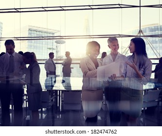 Multi-Ethnic Group Of Business People Working In A Board Room