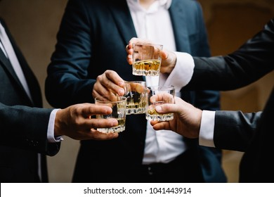 Multiethnic group of businessmen spending time together drinking