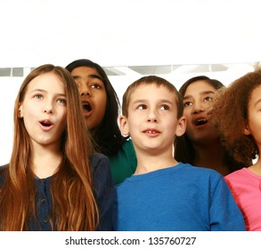 multi-ethnic group of children singing with copy space