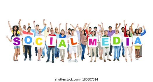 Multi-Ethnic Group of Diverse People Holding The Word Social Media