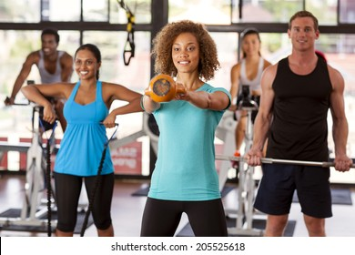 Multi-ethnic group doing various exercises in a gym class
