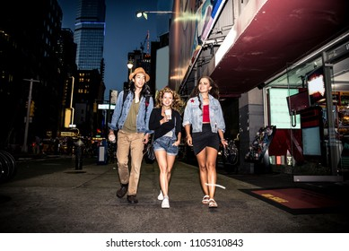 Multi-ethnic group of friends bonding outdoors - Young people walking and talking on the streets