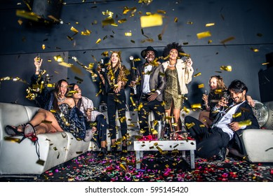 Multi-ethnic group of friends celebrating in a nightclub - Clubbers having party