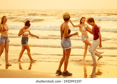 Multi-ethnic group of friends dance at the beach