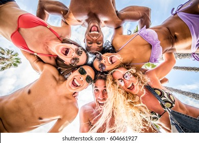 Multi-ethnic group of friends portrait at the beach