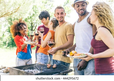 Multi-ethnic group of friends talking and having fun at a barbecue party