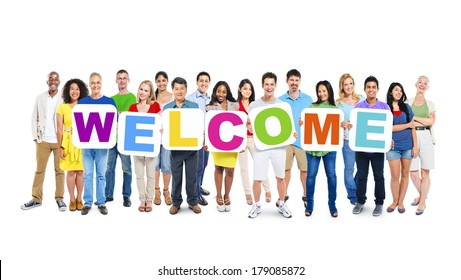 Multi-ethnic Group of People Holding Boards with Welcome